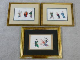 Three antique Chinese rice paper paintings of various people. One is of two characters acting out