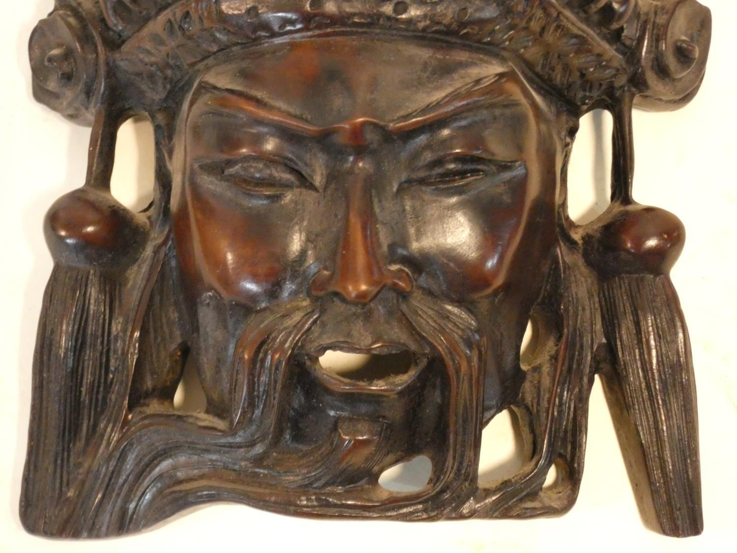 A collection of Chinese figures and masks. Including a resin wood effect mask, a carved wooden - Image 10 of 14