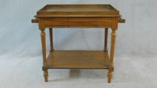 A late 19th century French walnut washstand with galleried top and towel rails on turned reeded