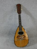An early 20th century mandolin with mother of pearl and tortoiseshell inlay, signed Ozelli and