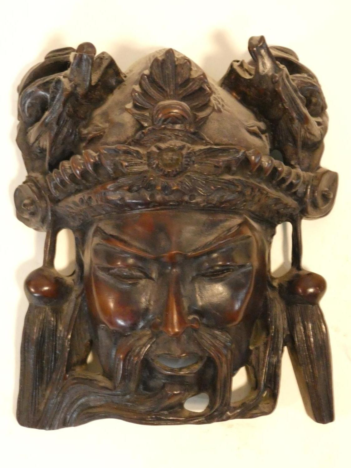 A collection of Chinese figures and masks. Including a resin wood effect mask, a carved wooden - Image 8 of 14