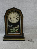 A late 19th century walnut cased mantel clock with enamel dial and Roman numerals and painted