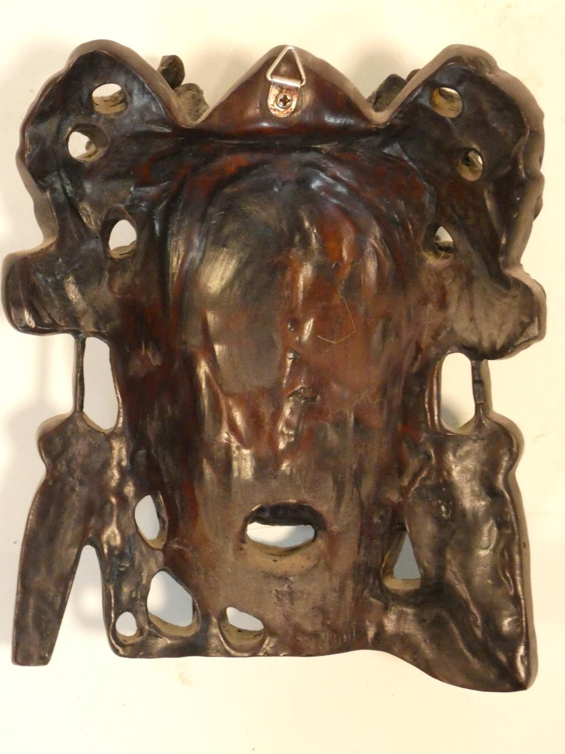 A collection of Chinese figures and masks. Including a resin wood effect mask, a carved wooden - Image 11 of 14