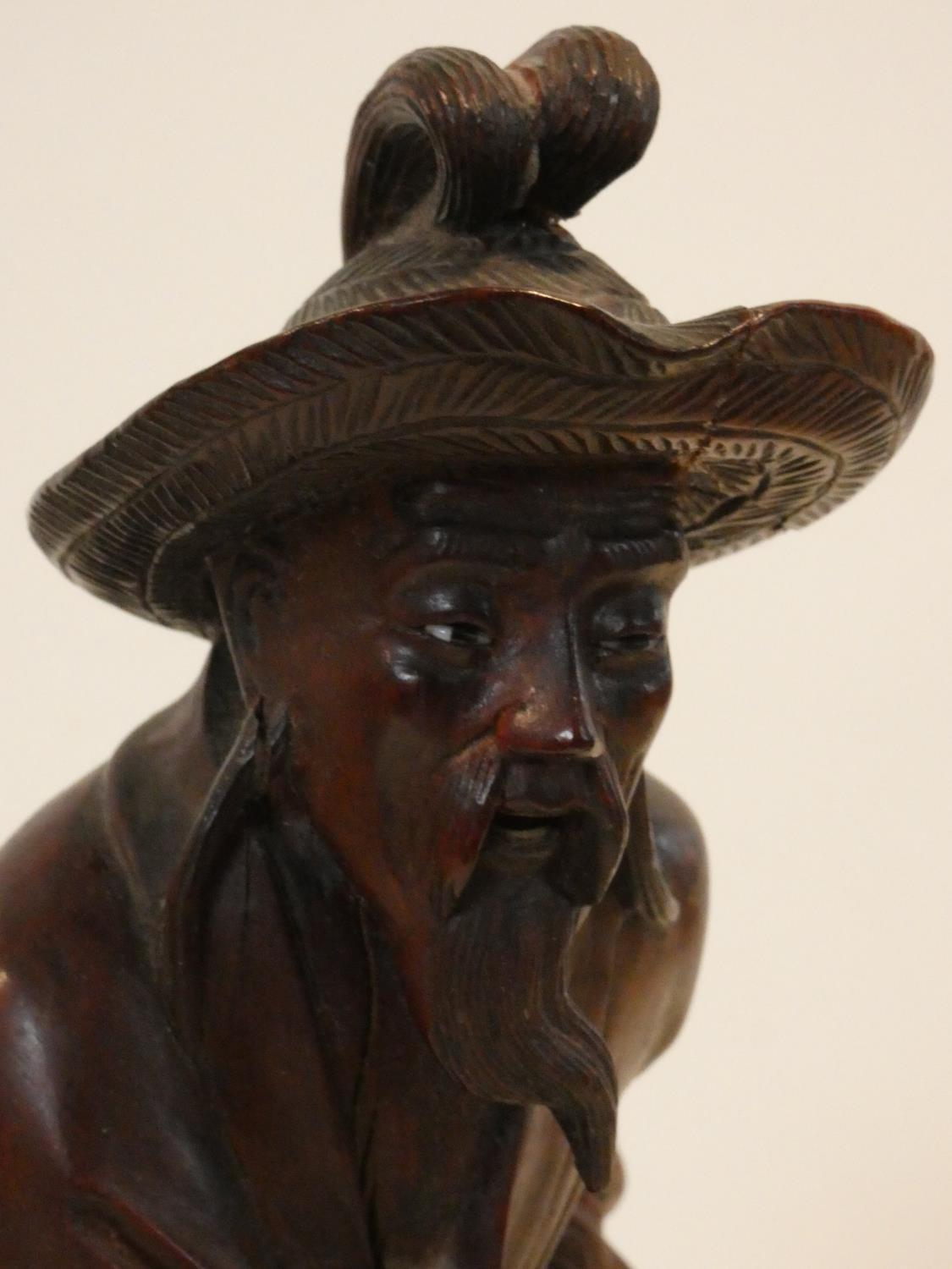 A collection of Chinese figures and masks. Including a resin wood effect mask, a carved wooden - Image 3 of 14
