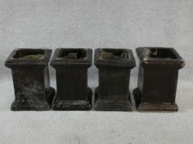 A set of four ceramic planters in grey glaze on stepped bases. H.23cm