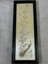 A late 19th century framed and glazed Chinese silk embroidery of a peacock with birds, butterflies