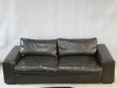 A vintage style brown leather down filled Collins & Hayes leather upholstered three seater sofa.
