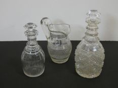Two antique cut crystal decanters and a crystal cross hatched design jug. H.28cm