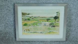 A framed and glazed watercolour of Santorini landscape by a British painter Anne Usborne. Signed and