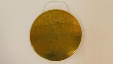 A vintage Egyptian revival engraved brass domed wall plaque with Eygptian symbols and Pharaohs.