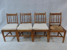 A set of four antique country elm dining chairs with carved rail backs and rush drop in seats. Three