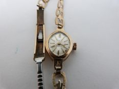 A vintage ladies gold cased Avia, 17 Jewels, Incabloc, Swiss made cocktail watch with articulated