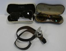 Two pairs of designer sunglasses and a belt. A pair of Chanel ladies sunglass frames and separate