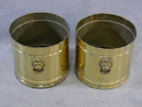 A pair of circular vintage brass coal buckets with lion head handles. H.28xD.30cm