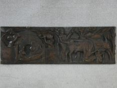 A carved African hardwood panel, farmers and cattle in a village setting, indistinctly signed to the