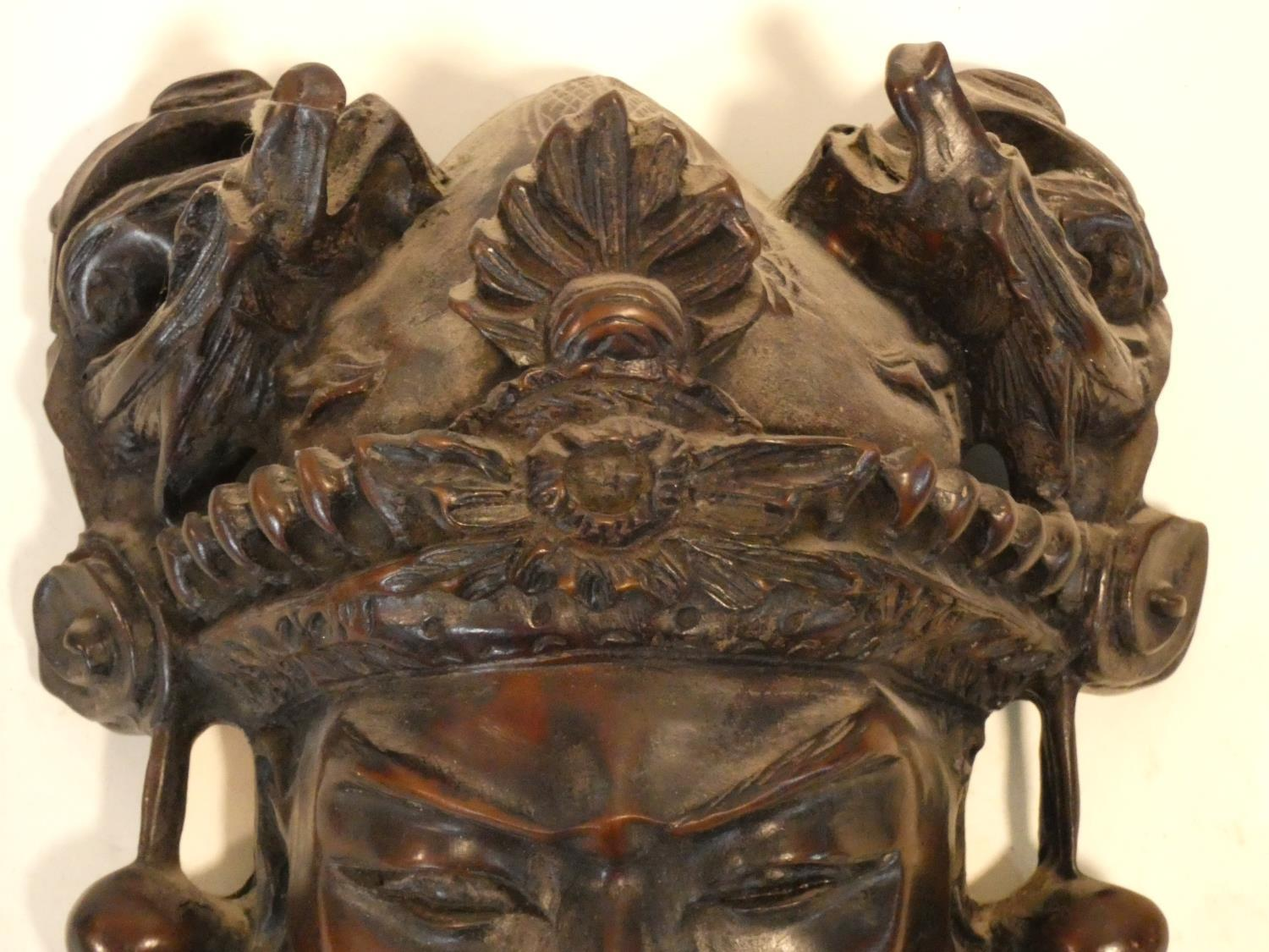 A collection of Chinese figures and masks. Including a resin wood effect mask, a carved wooden - Image 9 of 14