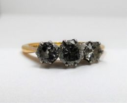 Am antique three stone diamond 18ct yellow gold and platinum ring. Set to centre with a round old