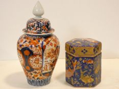 A Chinese lidded temple jar with all over Imari style decoration and a lidded hexagonal caddy with