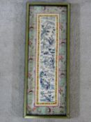 A 19th century Chinese framed and glazed silk panel, figures in a landscape within a floral woven