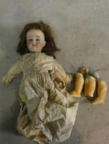 An antique German Armand Marseille bisque head girl doll, marked Made in Germany and with serial