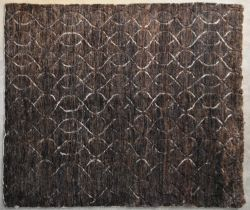 A contemporary carpet with allover scrolling interlocking pattern on a deep bronze field. L.