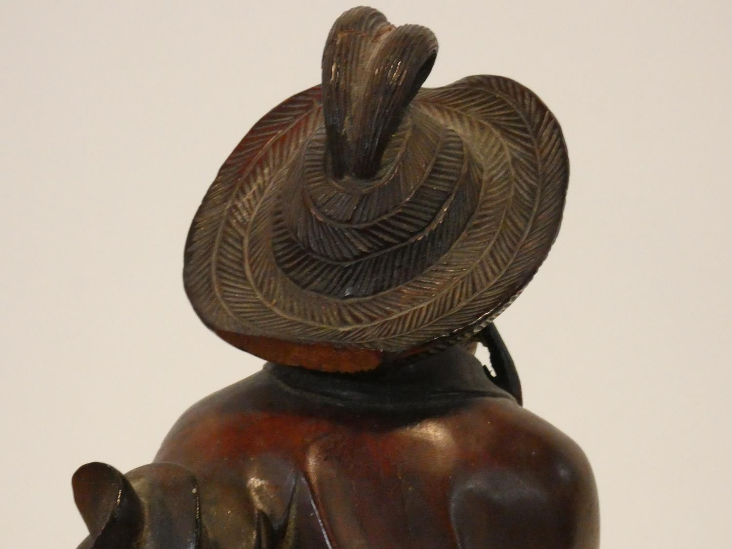 A collection of Chinese figures and masks. Including a resin wood effect mask, a carved wooden - Image 7 of 14