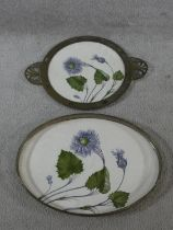 A pair of late 19th century German trays, hand painted with flower and leaf decoration, one with