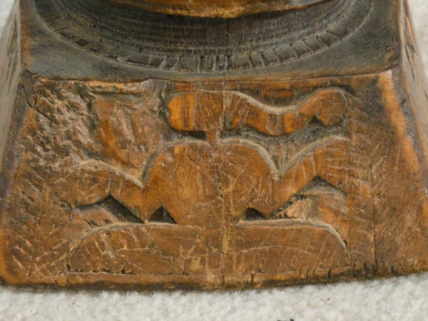 An antique Indian hardwood seed sowing tool with carved detailing of animals and people. H.13 W.17 - Image 7 of 8