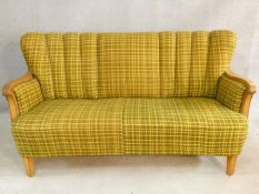 A mid century vintage Continental satin birch framed sofa in lemon and sage woven textile