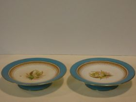 A pair of 19th century Royal Worcester comports with pale blue and gilt detailed rims and hand