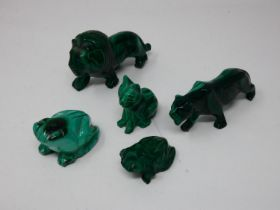 A miscellaneous collection of carved malachite animal figures to include prowling lions, a seated
