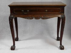 A 19th century mahogany side table in the Irish Georgian style with frieze drawer above carved