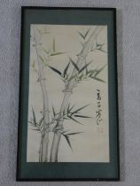 A Japanese framed and glazed watercolour study on silk of bamboo leaf and branches, signed and