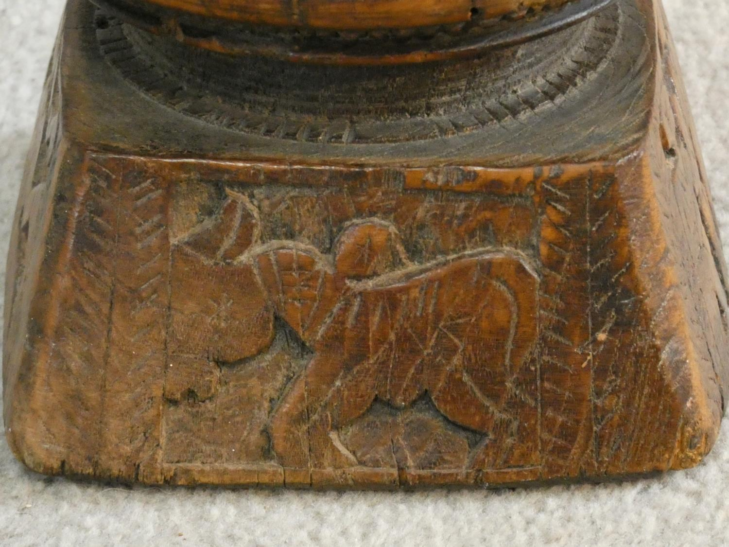 An antique Indian hardwood seed sowing tool with carved detailing of animals and people. H.13 W.17 - Image 4 of 8