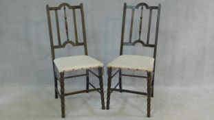 A pair of late 19th century stained beech bedroom chairs on stretchered bobbin turned supports. H.