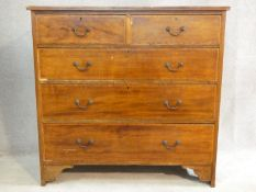 An Edwardian mahogany and satinwood with ebony inlaid chest of two short over three long drawers