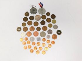 A collection of coins and medals. Including a silver coronation medal, A brass Victoria Jubilee