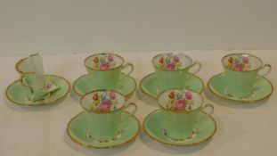 An antique Imperial Bone China five person tea set, gilded with 22kt gold and hand painted with a