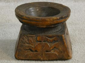 An antique Indian hardwood seed sowing tool with carved detailing of animals and people. H.13 W.17