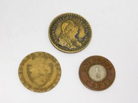 A collection of antique coins. Including a Victorian two metal One Penny Model coin, 1790 George III