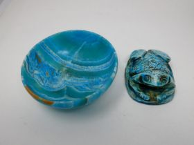 An Egyptian style turquoise glazed frog paperweight with heiroglyphs to the base along with a dyed