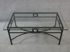 A metal framed conservatory low table with plate glass top. H.41xW.100xL.60cm