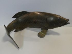 A Chinese stylised brass cast figure of a carp swimming. H.26xW.60cm