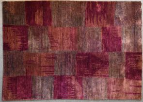 A contemporary rug with abstract chequerboard design in shades of plum. L.244x175cm