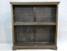 A mid century vintage oak open bookcase on bracket feet. H.107 W.106 D.29cm