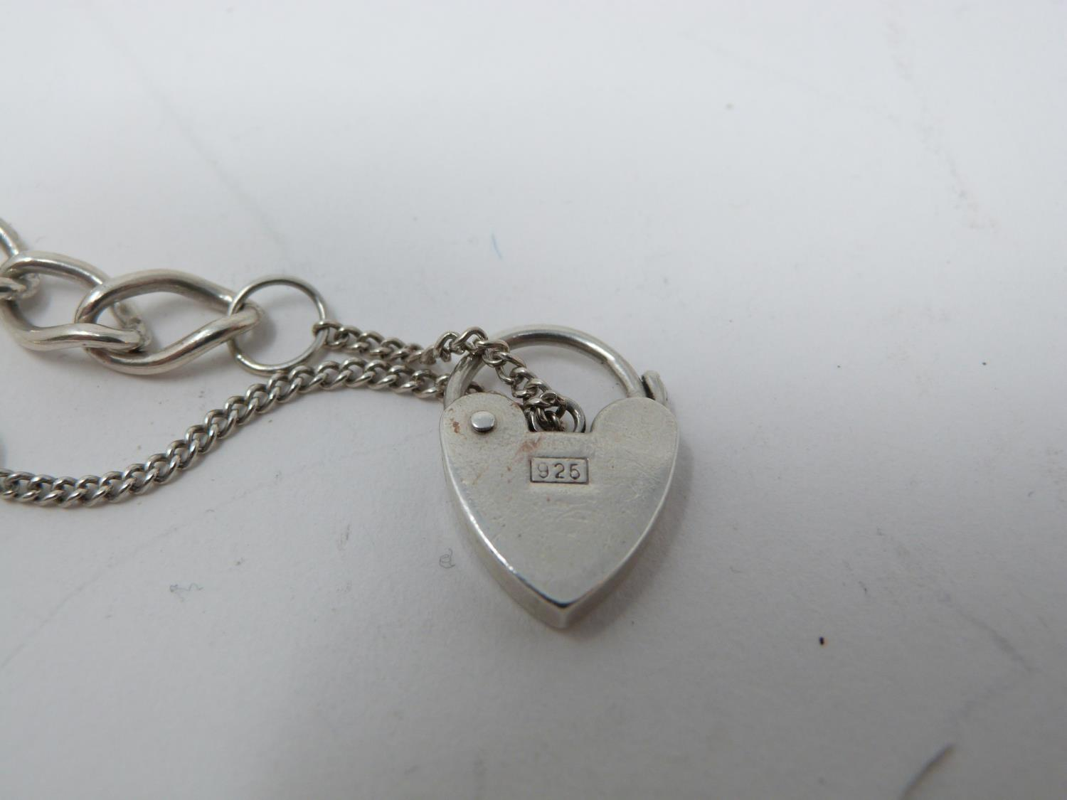 A collection of silver jewellery. Including a silver charm bracelet with heart padlock, a rainbow - Image 2 of 6