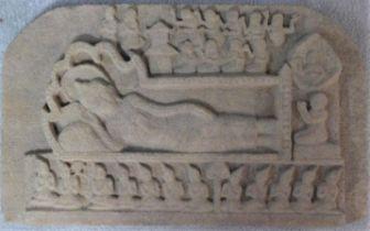 A carved sandstone Southeast Asian frieze of a reclining figure of Vishnu on serpent Anata