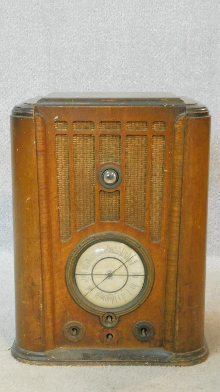 A vintage Pilot Radio Ltd valve radio in burr walnut Art Deco case. H.50 W.39 D.28cm