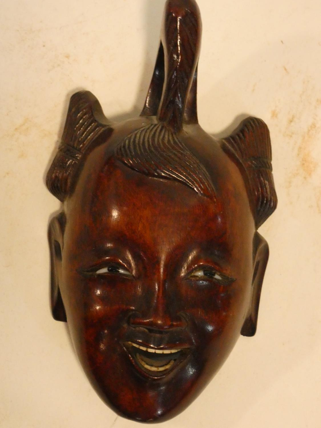 A collection of Chinese figures and masks. Including a resin wood effect mask, a carved wooden - Image 12 of 14