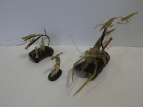 A 20th century Chinese carved horn figure group of prawns underwater in a naturalistic setting on